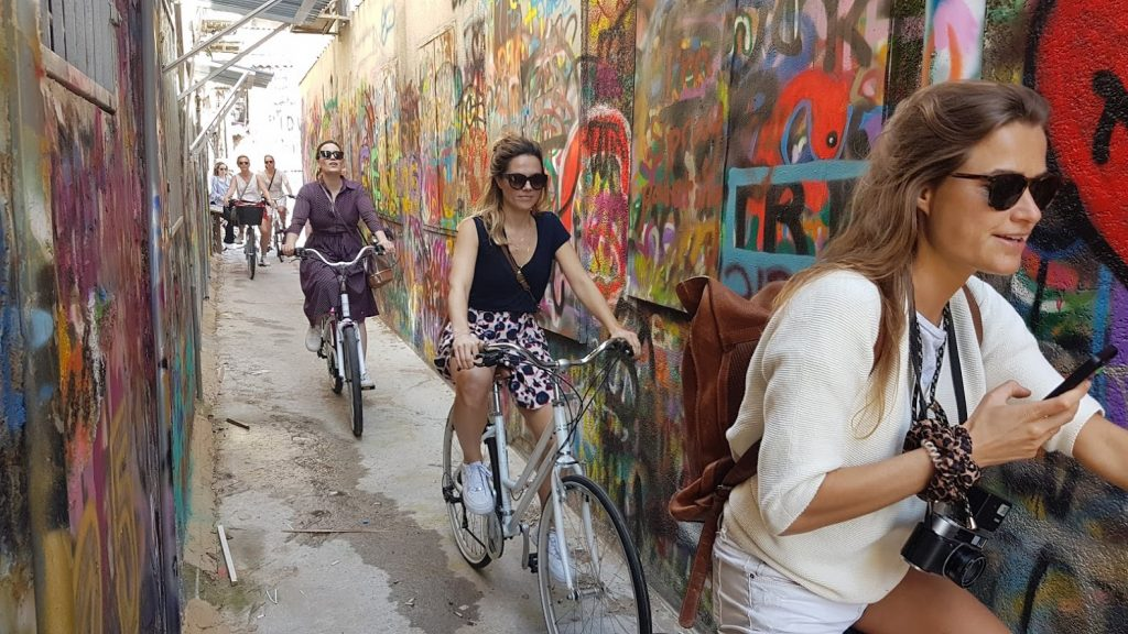 Riding through on of South Tel Aviv's alleys