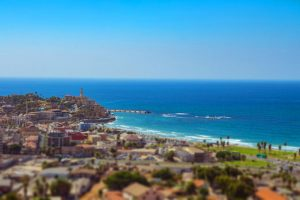 92425330 - aerial view of south tel aviv neighborhoods and old jaffa. recognized places such as the etzel museum, old jaffa port, tel aviv promenade and neve tzedek neighborhood. tilt shift.